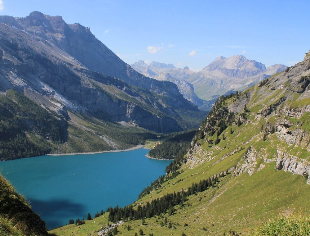 Oeaschinensee, an emerald blue lake above Kandersteg, is a must see on a hiking tour in the Bernese Oberland